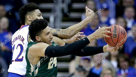 Ishmail Wainright Kansas' Kelly Oubre Jr. (12) and Baylor's Ishmail Wainright (24) battle for a rebound during the first half of an NCAA college basketball game in the semifinals of the Big 12 Conference tournament, in Kansas City, Mo