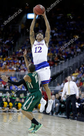 Kelly Oubre Jr Kansas' Kelly Oubre Jr. (12) gets past Baylor's Lester Medford (11) to catch a pass during the second half of an NCAA college basketball game in the semifinals of the Big 12 Conference tournament, in Kansas City, Mo. Kansas won 62-52