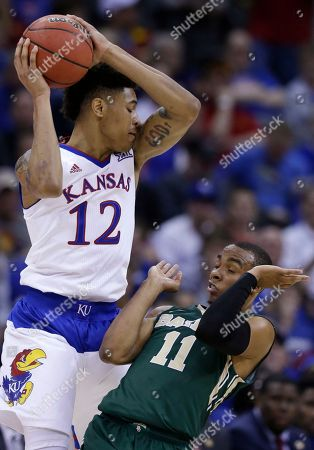 Kelly Oubre Jr., Lester Medford Kansas guard Kelly Oubre Jr. (12) catches an inbound pass while covered by Baylor guard Lester Medford (11) during the second half of an NCAA college basketball game in the semifinals of the Big 12 Conference tournament in Kansas City, Mo., . Kansas defeated Baylor 62-52