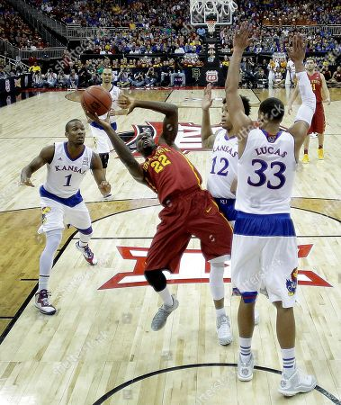 Dustin Hogue Iowa State's Dustin Hogue (22) gets past Kansas' Wayne Selden Jr. (1), Kelly Oubre Jr. (12) and Landen Lucas (33) to put up a shot during the first half of an NCAA college basketball game in the finals of the Big 12 Conference tournament, in Kansas City, Mo
