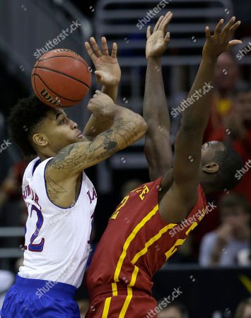 Dustin Hogue, Kelly Oubre Jr Iowa State forward Dustin Hogue (22) knocks the ball away from Kansas guard Kelly Oubre Jr. (12) during the second half of an NCAA college basketball game in the finals of the Big 12 Conference tournament in Kansas City, Mo