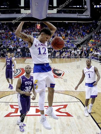 Kelly Oubre Jr Kansas' Kelly Oubre Jr. (12) gets past TCU's Trey Zeigler (32) to dunk the ball in the second half of an NCAA college basketball game in the quarterfinals of the Big 12 Conference tournament, in Kansas City, Mo. Kansas won 64-59
