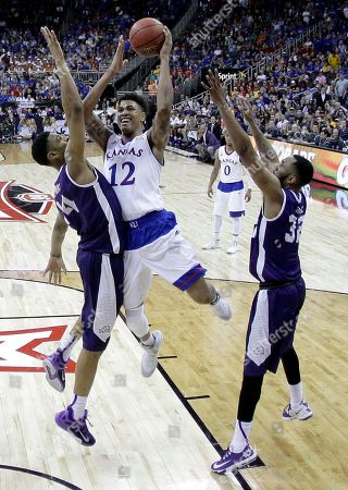 Kelly Oubre Jr Kansas' Kelly Oubre Jr. (12) shoots under pressure from TCU's Karviar Shepherd (14) during the second half of an NCAA college basketball game in the quarterfinals of the Big 12 Conference tournament, in Kansas City, Mo. Kansas won 64-59
