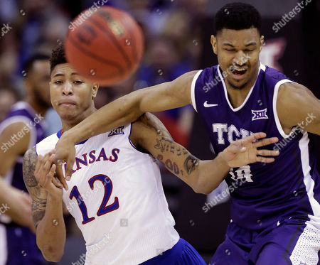 Kelly Oubre Jr., Karviar Shepherd Kansas guard Kelly Oubre Jr. (12) tangles with TCU center Karviar Shepherd (14) while chasing a loose ball during the first half of an NCAA college basketball game in the quarterfinal round of the Big 12 Conference tournament at the Sprint Center in Kansas City, Mo