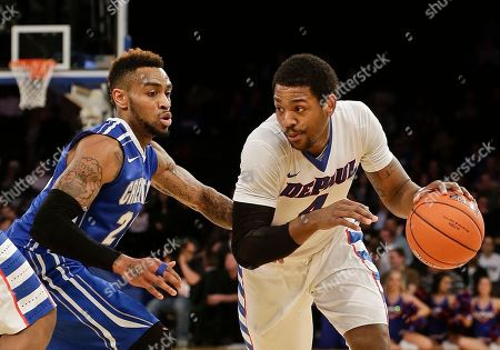 Myke Henry Creighton's James Milliken (23) defends DePaul's Myke Henry (4) during the first half of an NCAA college basketball game in the first round of the Big East Conference tournament, in New York