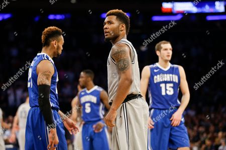 D'Vauntes Smith-Rivera Georgetown's D'Vauntes Smith-Rivera, center, reacts as Creighton's Rick Kreklow (15) and James Milliken (23) walk away during the second half of an NCAA college basketball game in the in the quarterfinals of the Big East Conference tournament, in New York. Georgetown won the game 60-55