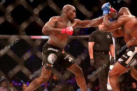 KIng Mo, Cheick Kongo Cheick Kongo pursues King Mo during their fight at Bellator 134, in Uncasville, CT. King Mo won via split decision