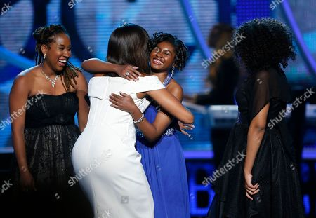 Stock Image of Michelle Obama, Kaya Thomas, Chental-Song Bembry, Gabrielle Jordan First Lady Michelle Obama, center left, hugs Making A Difference award winner Chental-Song Bembry, center right, as M.A.D. winners Kaya Thomas, left, and Gabrielle Jordan look on during a taping of the Black Girls Rock award ceremony at the New Jersey Performing Arts Center, in Newark