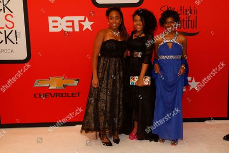 Stock Photo of Chental-Song Bembry, Kaya Thomas, left, Gabrielle Jordan Kaya Thomas, left, Gabrielle Jordan, center, and Chental-Song Bembry pose for photographers during the red carpet ahead of the Black Girls Rock award ceremony at the New Jersey Performing Arts Center, in Newark, N.J