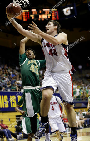 Chris Hansen, Jeremy Hemsley Campolindo's Chris Hansen, right, scores past Damien's Jeremy Hemsley in the second half of the boys' Division 3 CIF basketball championships, in Berkeley, Calif. Damien won 70-57