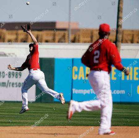Los Angeles Angels' Josh Rutledge makes a running catch on a ball hit by Milwaukee Brewers' Luis Jimenez during the fourth inning of a spring training baseball game, in Tempe, Ariz