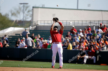 Los Angeles Angels' Albert Pujols catches a pop up off the bat of Milwaukee Brewers' Luis Jimenez during the second inning of a spring training baseball game, in Tempe, Ariz