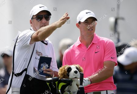 Rory McIlroy, J P Fitzgerald Rory McIlroy of Northern Ireland, right, listens to his caddie J P Fitzgerald on the third tee during the third round of the Cadillac Championship golf tournament, in Doral, Fla
