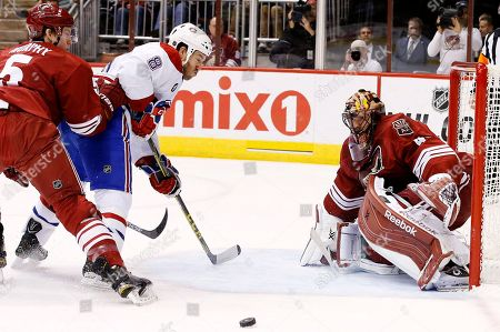 Mike Smith, Connor Murphy, Brandon Prust Arizona Coyotes' Mike Smith, right, makes a save on a shot by Montreal Canadiens' Brandon Prust (8) as Coyotes' Connor Murphy (5) defends during the first period of an NHL hockey game, in Glendale, Ariz