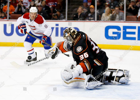 Anaheim Ducks goalie John Gibson, right, blocks a shot by Montreal Canadiens right wing Brandon Prust during the first period of an NHL hockey game in Anaheim, Calif