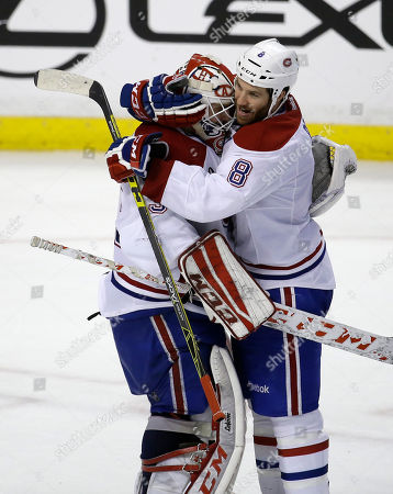 Brandon Prust, Dustin Tokarski Montreal Canadiens' Brandon Prust (8) hugs goalie Dustin Tokarski, left, after an NHL hockey game against the Florida Panthers, in Sunrise, Fla. The Canadiens defeated the Panthers 3-2