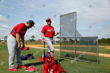 Mark Reynolds, Peter Bourjos St. Louis Cardinals' Peter Bourjos, right, and Mark Reynolds prepare to take batting practice during a spring training baseball workout, in Jupiter, Fla