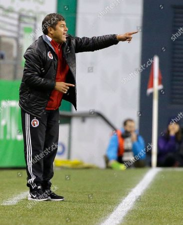 Club Tijuana coach Daniel Guzman calls to his team during the first half of an international friendly soccer match against the Seattle Sounders, in Seattle