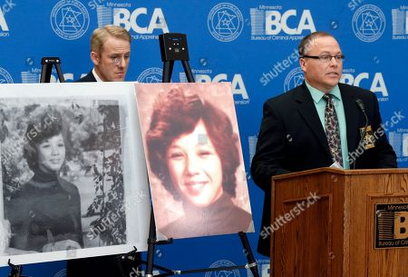 Michael Gormley, Drew Evans Photos of murder victim Michelle Busha are displayed as Faribault County Sheriff Michael Gormley, right, addresses a news conference, at the Bureau of Criminal Apprehension in St. Paul, Minn. Mitochondrial and DNA testing on the remains in the cold case led to the identity of Busha, of Bay City, Texas, whose body was found near Blue Earth, Minn. in 1980. Authorities said Robert Leroy Nelson, a Minnesota State Patrol trooper at the time, confessed to the crime nine years later. Listening, left, is BCA assistant Superintendent Drew Evans
