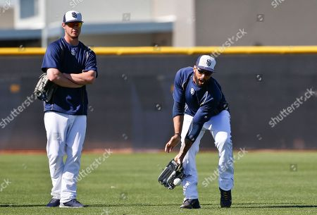 Matt Kemp, Wil Myers San Diego Padres left fielder Matt Kemp gets handcuffed by a bad hop while trying tom field a ball as teammate Wil Myers looks on prior to a spring training baseball game against the Chicago Cubs, in Peoria, Ariz