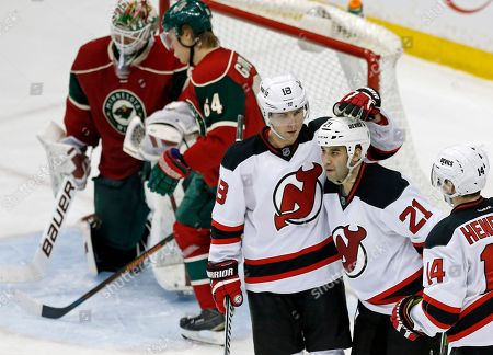 Scott Gomez, Steve Bernier, Devan Dubnyk New Jersey Devils' Scott Gomez (21) is congratulated by New Jersey Devils' Steve Bernier (18) after Gomez's goal against Minnesota Wild goalie Devan Dubnyk, top left, in the third period of an NHL hockey game, in St. Paul, Minn. The Wild won 6-2