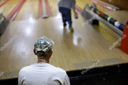 Stock Picture of Jerry Middleton, Jon Middleton Jerry Middleton watches as his son Jon hurls a duckpin bowling ball during a tournament at Shenandoah Bowling Lanes, in Mount Jackson, Va. The sport, which is mostly played in the Mid-Atlantic, enjoyed its peak in the 1960s