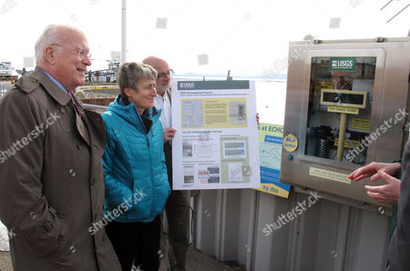 Patrick Leahy, Sally Jewell, Keith Robinson U.S. Sen. Patrick Leahy, D-Vt., left, U.S. Interior Secretary Sally Jewell, center, and Keith Robinson, right, the director of the New England Water Science Center of the U.S. Geologic Survey, listen to an explanation about a flood gauge located on the shore of Lake Champlain in Burlington, Vermont . Jewell gave the keynote address at an environmental summit meeting where Vermonters searched ways to protect property and infrastructure from future flooding caused by climate change