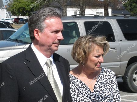 "Richard and Elizabeth Jones, whose daughter was killed by a train on a Georgia movie set last year, speak with reporters outside the Wayne County Courthouse, in Jesup, Ga., after the film's director and executive producer pleaded guilty to charges of involuntary manslaughter and criminal trespassing. Director Randall Miller and executive producer Jay Sedrish had just begun filming ""Midnight Rider,"" a movie about singer Gregg Allman, when a train plowed into their crew Feb. 20, 2014, killing camera assistant Sarah Jones and injuring six others"