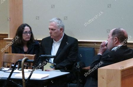 "Stock Picture of Film director Randall Miller, center, sits in a Georgia courtroom with his wife, Jody Savin before pleading guilty to charges of involuntary manslaughter and criminal trespassing . Miller was filming ""Midnight Rider,"" a biographical movie about singer Gregg Allman, when a freight train plowed into his crew on a railroad bridge last year. Camera assistant Sarah Jones was killed and six others were injured"
