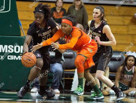 Shakayla Thomas, Michelle Woods Florida State's Shakayla Thomas (20) and Leticia Romero (10) battle Miami's Michelle Woods (10) for the ball during the second half of an NCAA basketball game in Coral Gables, Fla., . Florida State won 69-55