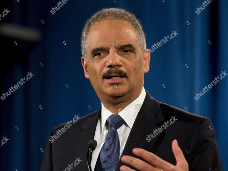 """Eric Holder Then-Attorney General Eric Holder speaks at the Justice Department in Washington. Holder says Edward Snowden performed a """"public service"""" in stoking a national debate about secret domestic surveillance programs, but that he should still return to the U.S. to stand trial. Holder spoke with CNN political commentator David Axelrod in a podcast released May 30, 2016"""