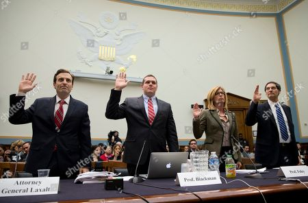"""Adam Laxalt, Josh Blackman, Stephen Legomsky, Elizabeth Price Foley From left, Nevada Attorney General Adam Laxalt, Professor Josh Blackman of the South Texas College of Law, Professor Elizabeth Price Foley of the Florida International University College of Law, and Professor Stephen Legomsky of the Washington University School of Law, are sworn in on Capitol Hill in Washington, prior to testifying before a House Judiciary hearing: """"The Unconstitutionality of Obama's Executive Actions on Immigration"""