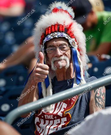 Stock Photo of Jon Brittain Jon Brittain, who says he is also known as Chief Wahoo, gives the Indians a thumbs up during a spring training baseball game against the Seattle Mariners, in Peoria, Ariz