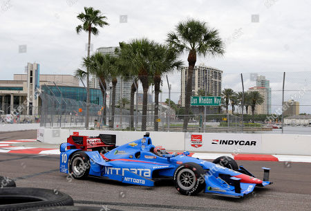 Tony Kanaan, of Brazil, drives onto Dan Wheldon Way during practice for the IndyCar Firestone Grand Prix of St. Petersburg auto race, in St. Petersburg, Fla. The race takes place on Sunday