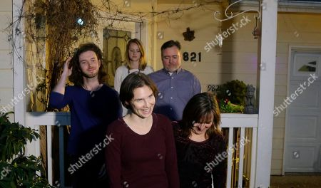 Amanda Knox, center, smiles as she walks with her mother, Edda Mellas, lower right, and her boyfriend, Colin Sutherland, left, as she walks to talk to reporters outside Mellas' home, in Seattle. Earlier in the day, Italy's highest court overturned the murder conviction against Knox and her ex-boyfriend over the 2007 slaying of Knox's roommate in Italy