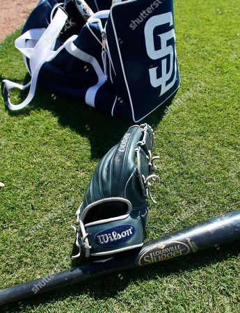 Louisville Slugger, Wilson Sporting Goods A Wilson A2000 glove and a Louisville slugger bat sit on the field prior to a spring training baseball game between the San Diego Padres and the Chicago White Sox, in Peoria, Ariz. Hillerich & Bradsby Co., the company that made bats for a who's who of baseball greats, including Babe Ruth and Ted Williams, announced a deal Monday to sell its Louisville Slugger brand to rival Wilson Sporting Goods Co. for $70 million