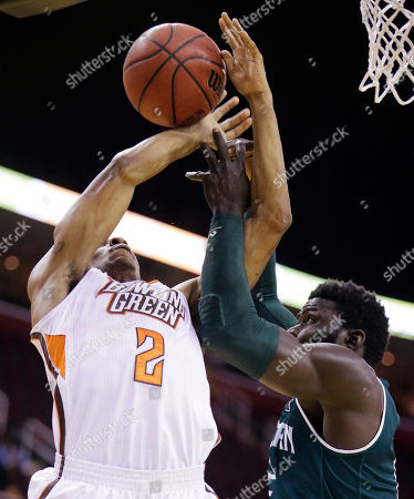 Olalekan Ajayi, Anthony Henderson Bowling Green's Anthony Henderson, left, and Eastern Michigan's Olalekan Ajayi, right, reach for the ball during the first half of NCAA college basketball game at the Mid-American Conference tournament, in Cleveland