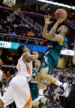 Mike Talley, Anthony Henderson Eastern Michigan's Mike Talley, right, drives to the basket against Bowling Green's Anthony Henderson during the second half of an NCAA college basketball game in the second round of the Mid-American Conference tournament, in Cleveland. Eastern Michigan defeated Bowling Green 73-67