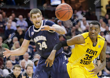 Pat Forsythe, Jimmy Hall Akron's Pat Forsythe (34) and Kent State's Jimmy Hall (35) watch the ball during the second half of an NCAA college basketball game in the third round of the Mid-American Conference tournament, in Cleveland. Akron defeated Kent State 53-51