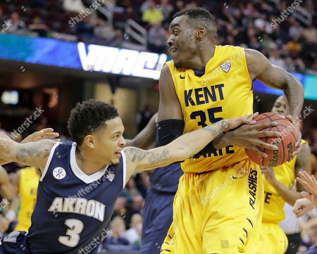Jimmy Hall, Nyles Evans Akron's Nyles Evans (3) tries to grab the ball from Kent State's Jimmy Hall (35) during the first half of an NCAA college basketball game in the third round of the Mid-American Conference tournament, in Cleveland