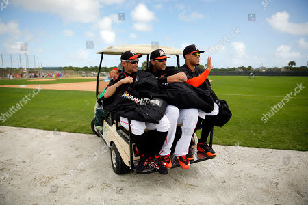 Stock Image of Ichiro Suzuki, Michael Morse, Giancarlo Stanton Miami Marlins' Ichiro Suzuki, left, Michael Morse, center, and Giancarlo Stanton cram onto the back of a golf cart as they are transported to a new field and another drill during spring training baseball practice, in Jupiter, Fla