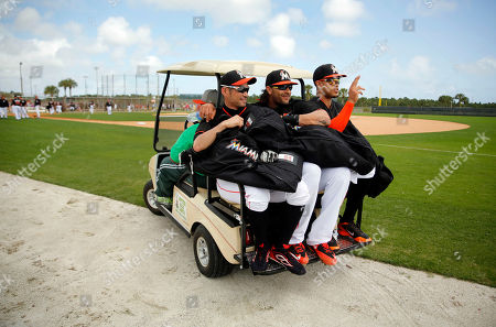 Stock Picture of Ichiro Suzuki, Michael Morse, Giancarlo Stanton Miami Marlins' Ichiro Suzuki, left, Michael Morse, center, and Giancarlo Stanton cram onto the back of a golf cart as they are transported to a new field for another spring training baseball drill, in Jupiter, Fla