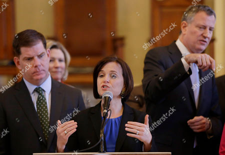 Betsy Hodges, Marty Walsh, Bill de Blasio Minneapolis Mayor Betsy Hodges addresses members of the media during an availability after a U.S. Conference of Mayor's Cities of Opportunity Task Force session at historic Faneuil Hall, in Boston. Boston Mayor Marty Walsh, left, looks on as New York City Mayor Bill de Blasio talks with a colleague