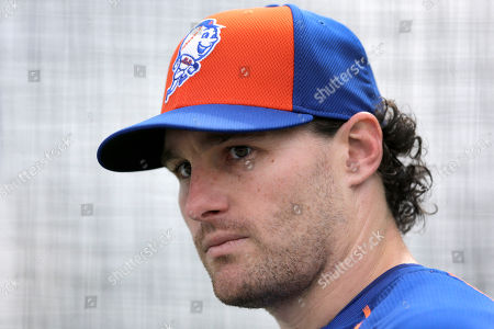 """Daniel Murphy New York Mets' Daniel Murphy pauses while working out in a batting cage during a spring training baseball practice in Port St. Lucie, Fla. Murphy says he disagrees with the """"lifestyle"""" of people who are gay. The Mets hosted Billy Bean, a former major leaguer who came out after retiring and is MLB's first ambassador for inclusion, to talk at spring training. Murphy spoke to NJ Advance Media afterward"""