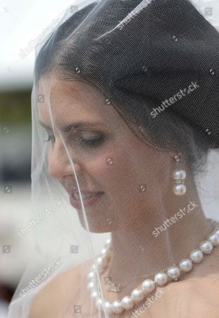 Gina Thomas Gina Thomas, of Naples, Fla., listens during a ceremony as she gets married to Jason Thomas during a group wedding and vow renewal as part of a week-long centennial celebration, in Miami Beach, Fla