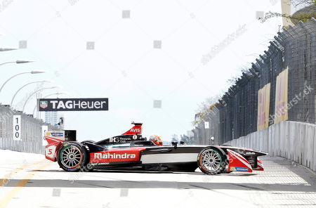 Karun Chandhok Karun Chandhok in the Mahindra Racing car recovers after spinning out on a turn during a qualifying round for the Formula E Miami ePrix auto race, in Miami. The race features a field of 10 teams of two drivers racing electric powered open-wheel Formula cars