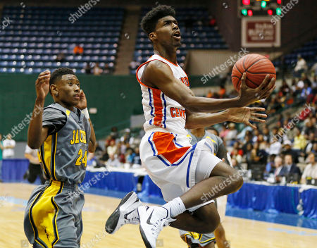 Stock Image of Leroy Buchanan, Josh Skinner Madison Central's Leroy Buchanan, front right, leaps past Starkville's Josh Skinner (24) while trying to make a layup in the first half of their MHSAA Class 6A boys' championship basketball game in Jackson, Miss