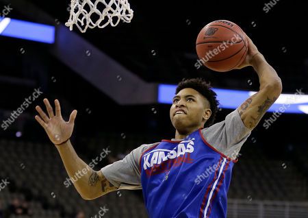 Kelly Oubre Jr Kansas guard Kelly Oubre Jr. drives to the basket during practice for an NCAA college basketball tournament second round game, in Omaha, Neb. Kansas plays New Mexico State on Friday