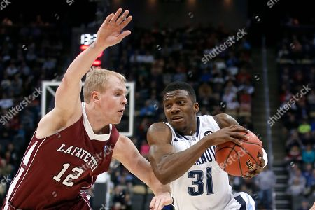 Dylan Ennis, Seth Hinrichs Villanova's Dylan Ennis (31) drives on Lafayette's Seth Hinrichs (12) during the first half of an NCAA tournament second round college basketball game, in Pittsburgh