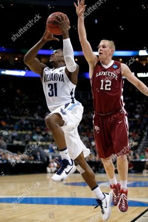 Dylan Ennis, Seth Hinrichs Villanova's Dylan Ennis (31) shoots in front of Lafayette's Seth Hinrichs (12) during the first half of an NCAA tournament second round college basketball game, in Pittsburgh